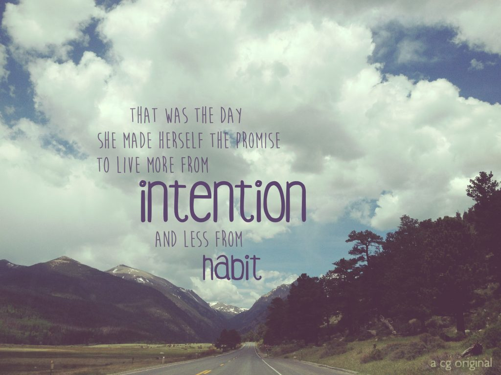live from intention and less from habit quote with a road through the rocky mountains in colorado as the background.