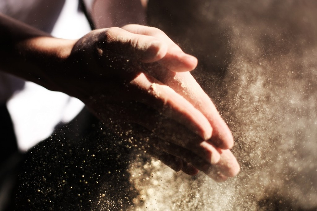 Hands wiping themselves free of dust
