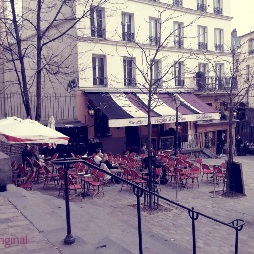 A contented gypsy original photo taken outside Relais De La Butte in Montmartre located in Paris