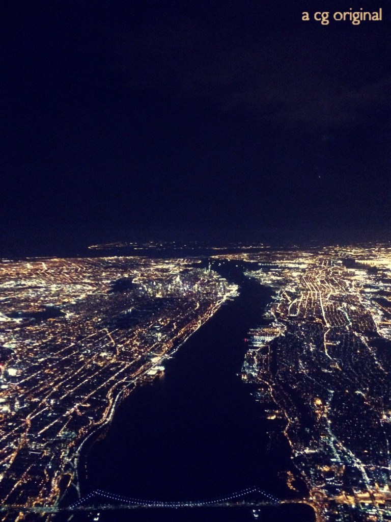 A cg original photo. This is a night aerial shot of Manhattan taken right after take off from LaGuardia airport.